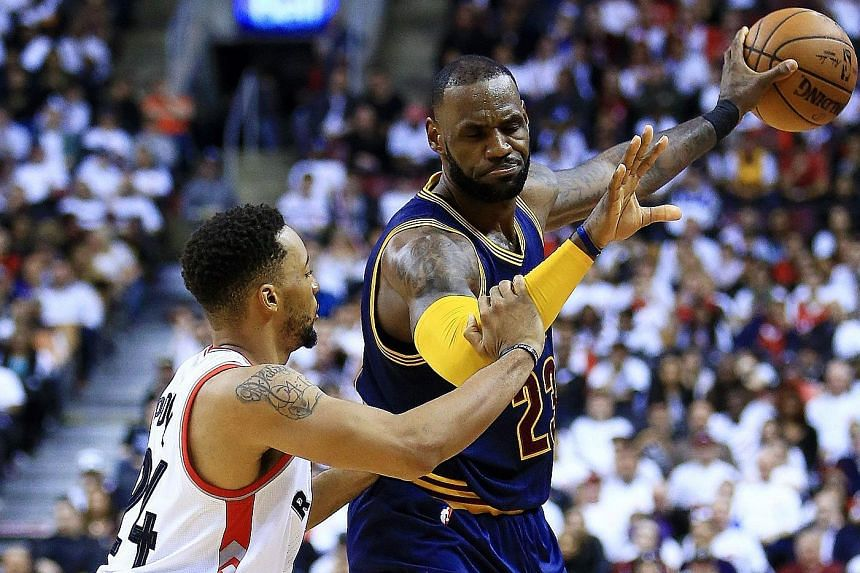 Cleveland's LeBron James shielding the ball away from Toronto's Norman Powell in Game 3 of the Eastern Conference semi-finals. The Cavaliers won 115-94 to take a 3-0 lead.