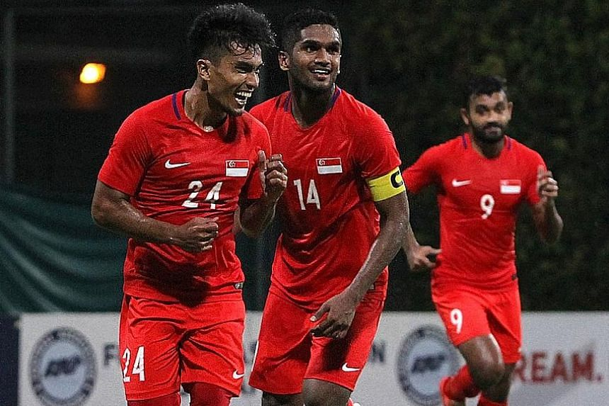 Yasir Hanapi (No. 24) celebrating after scoring for the Lions. The team are ranked 160th in the world and this is the time to look to the future by unearthing a new generation of players.