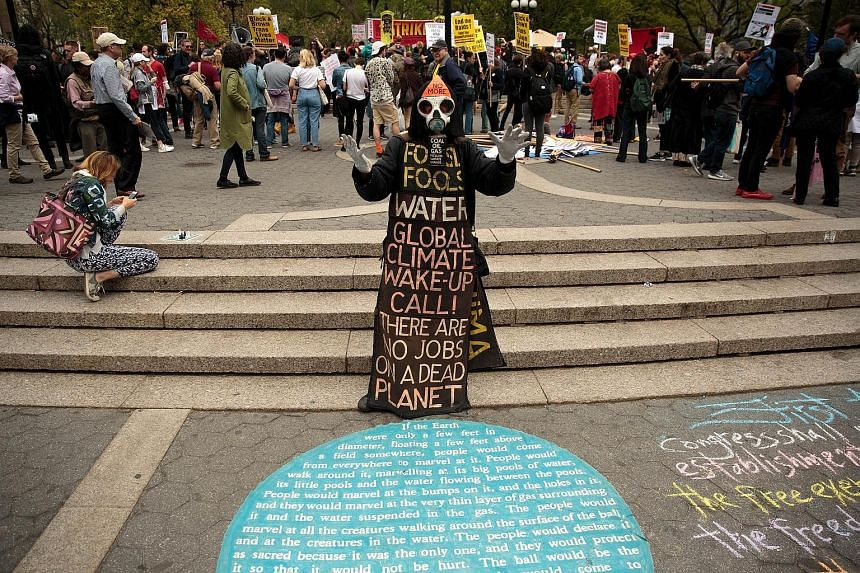 A protester warning against the dangers of climate change during a May Day rally in Union Square, New York, on May 1. The 21st century has seen 16 of the 17 hottest years since records began in 1880. Arctic summer sea ice also shrank to 4.14 million