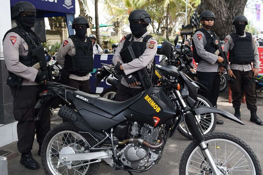 Members of the Indonesia special police prepare for their security patrol in Kuta near Denpasar, on Indonesia's resort island of Bali on March 23, 2017.