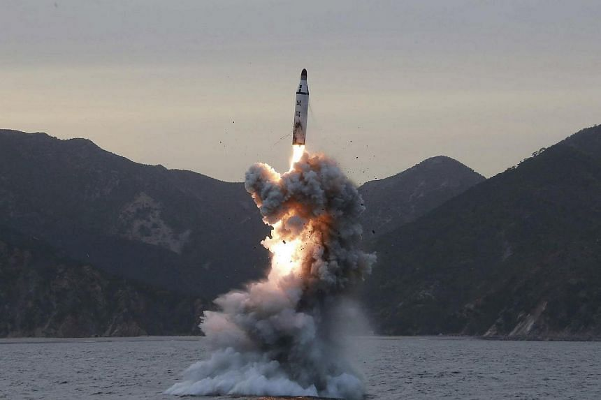 An undated file photo released on April 24, 2016 by North Korean Central News Agency shows an 'underwater test-fire of strategic submarine ballistic missile' in North Korea.