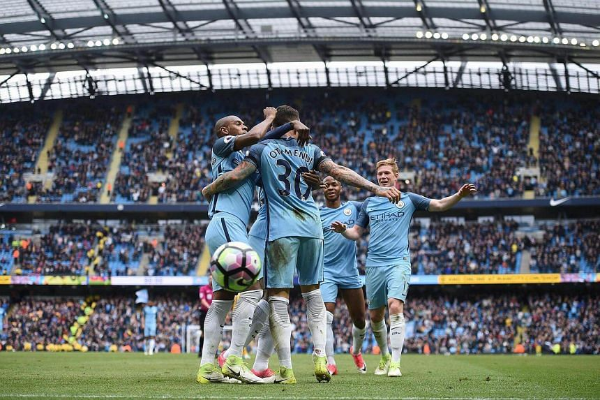 Manchester City's Argentinian defender Nicolas Otamendi (centre) celebrates scoring his team's fifth goal during the English Premier League football match between Manchester City and Crystal Palace at the Etihad Stadium in Manchester, UK, on May 6, 2