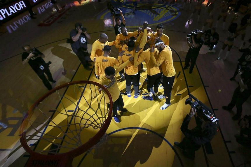The Golden State Warriors huddle up before their start against the Utah Jazz in the NBA Western Conference semifinal game two at Oracle Arena in Oakland, California, USA, on May 4, 2017.