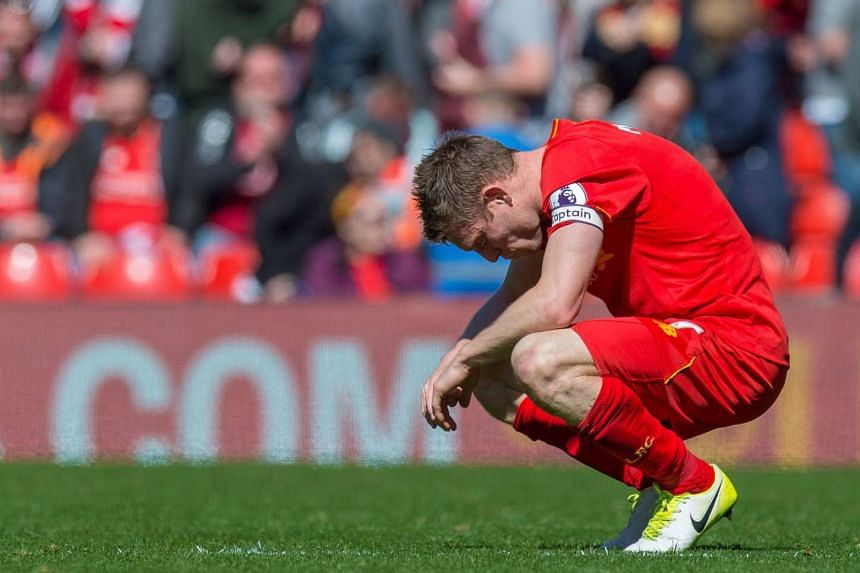 James Milner reacts after the final whistle.