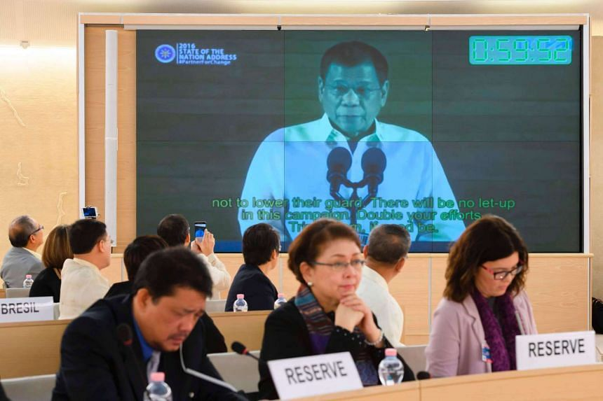 People listen to a speech delivered by Philippines' President Rodrigo Duterte shown on a screen during the universal periodic review of the Philippines by the Office of the United Nations High Commissioner for Human Rights on May 8, 2017.