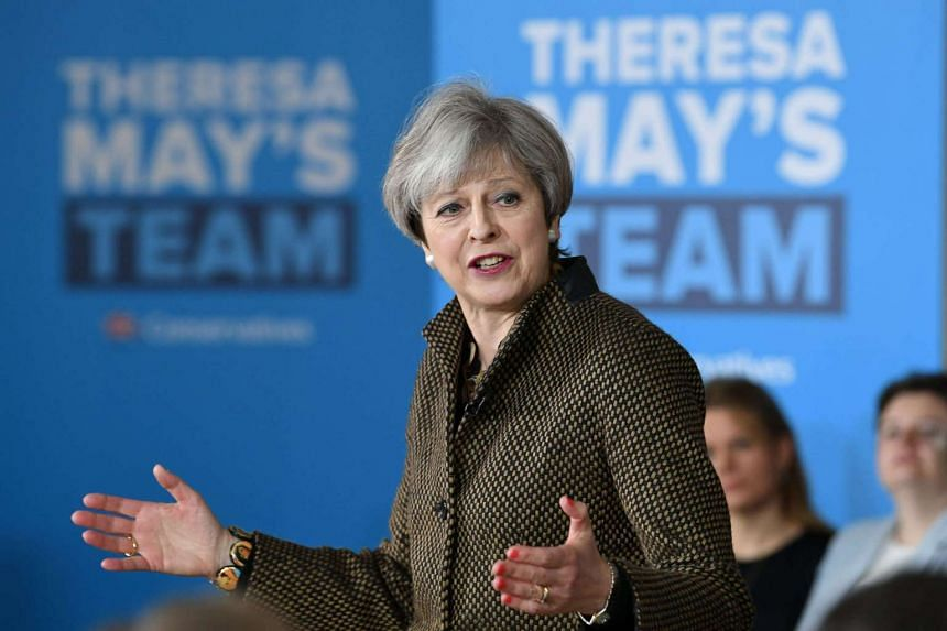 Britain's Prime Minister Theresa May addresses Conservative parliamentary candidates for London and the south east at the Dhamecha Lohana Centre in Harrow, north west London, on May 8, 2017.