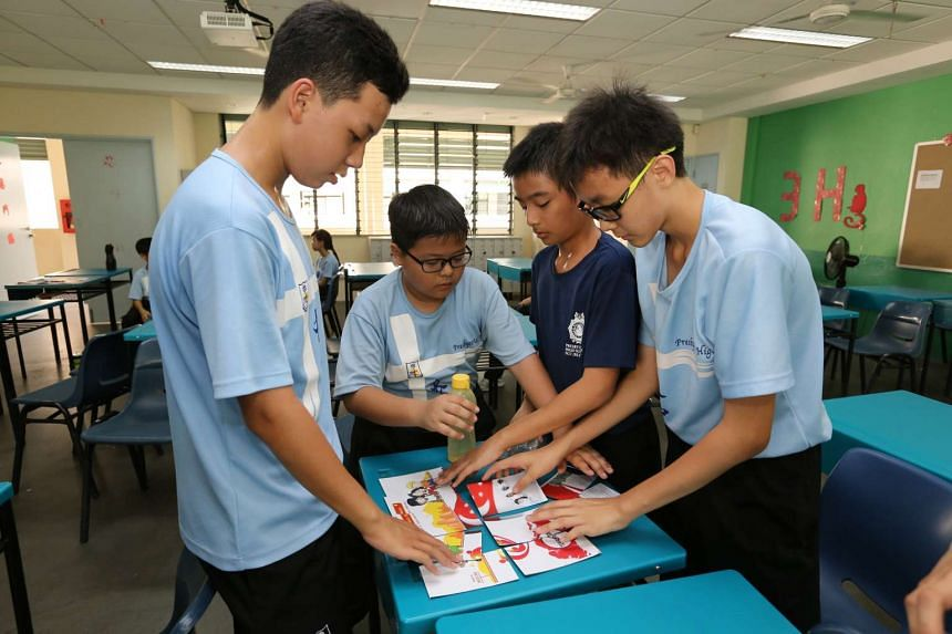 Students from Presbyterian High School trying to assemble a puzzle.