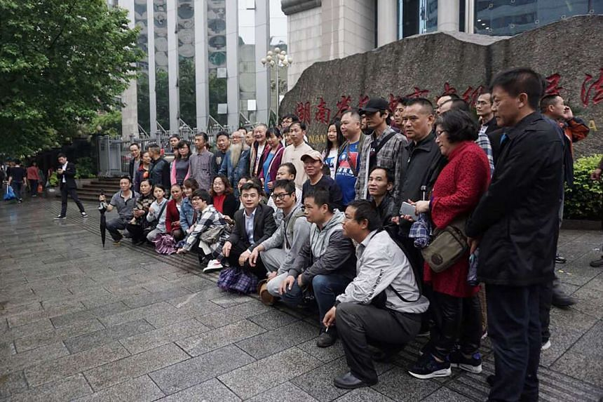 Supporters of lawyer Xie Yang gather outside the Intermediate People's Court in Changsha on April 25, 2017.