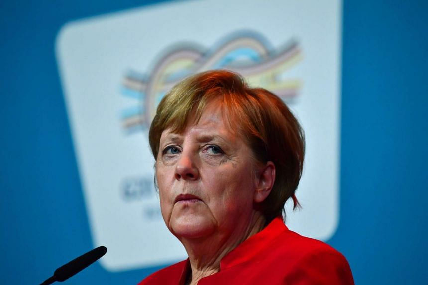 German Chancellor Angela Merkel delivers a statement after taking part in the Summit of the Business20 (B20) in Berlin on May 3, 2017.