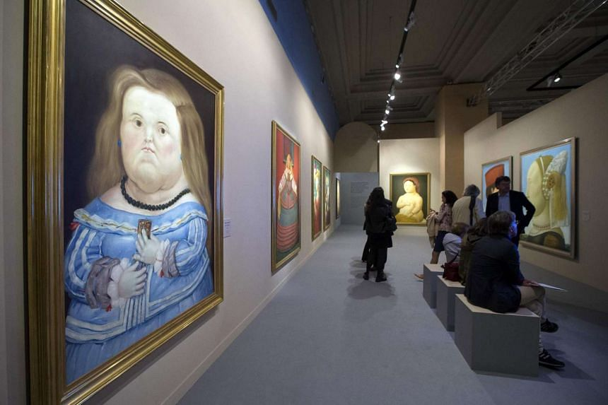 The work D'apres Velasquez (left) by Colombian artist Fernando Botero on display at his exhibition in Rome, Italy.