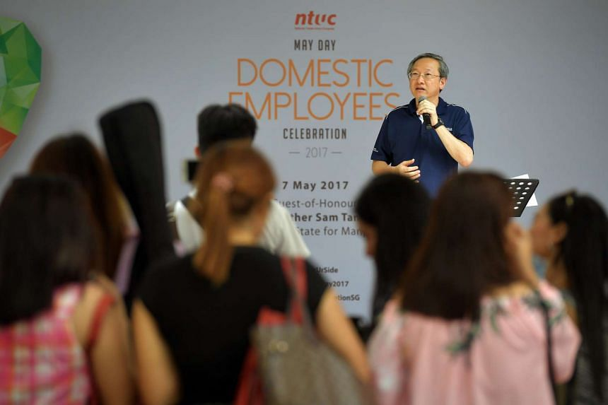 Minister of State for Manpower Sam Tan making an announcement on insurance for maids.