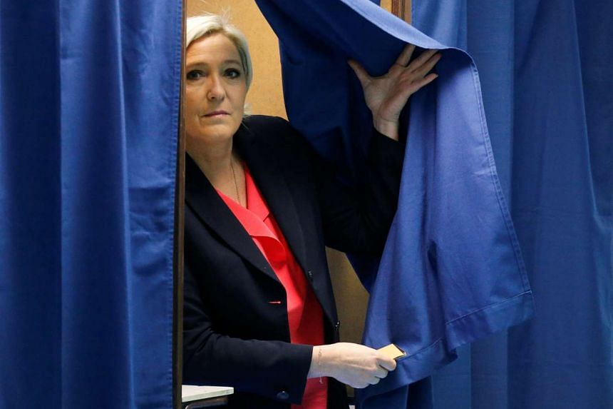 Marine Le Pen, French National Front (FN) political party candidate for French 2017 presidential election, exits a polling booth in the second round of 2017 French presidential election on May 7, 2017.