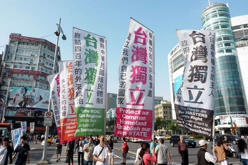 Taiwanese parading with banners demanding Taiwan independence in central Taipei, Taiwan, on Sunday (May 7).