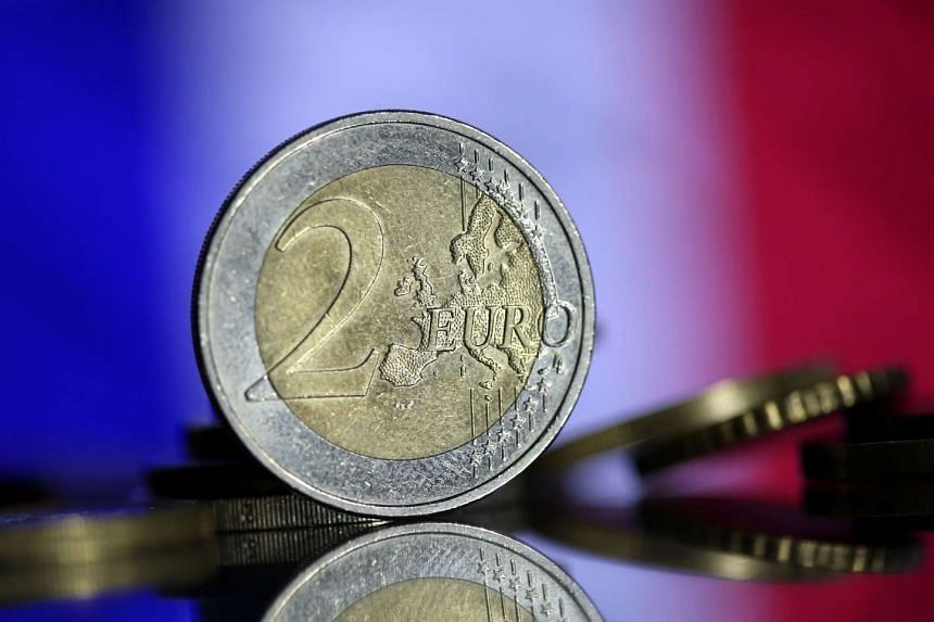 Euro coins  displayed against the French flag.
