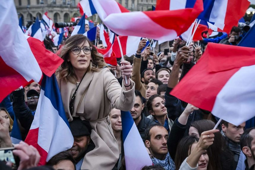 Supporters of French presidential-elect Emmanuel Macron celebrating his win.