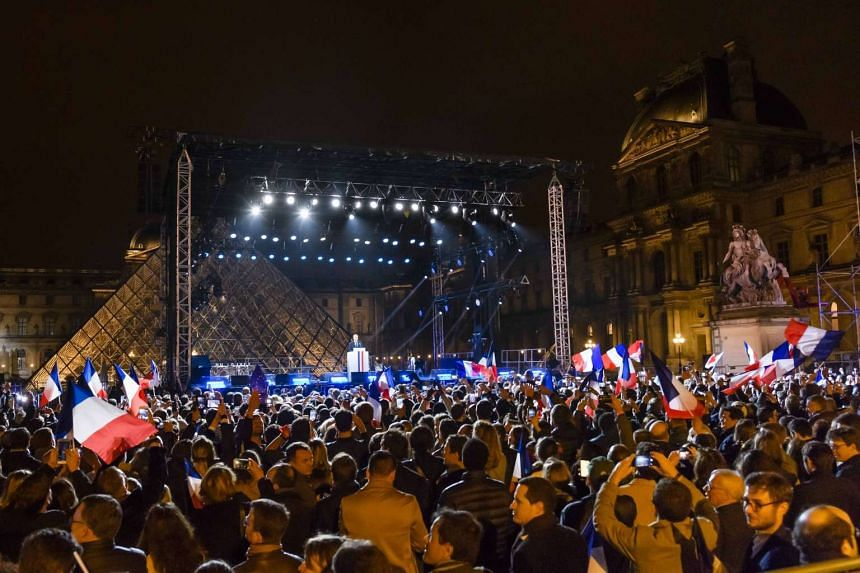 Emmanuel Macron celebrating at the Carrousel du Louvre after he won the second round of the French presidential elections, on May 7, 2017.