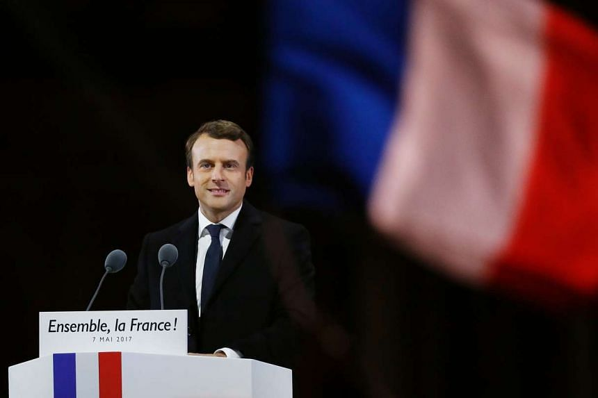 French president-elect Emmanuel Macron delivering a speech at the Pyramid at the Louvre Museum in Paris.
