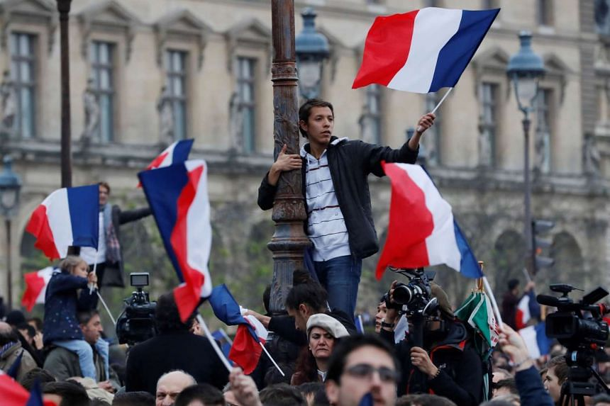 Supporters of French president-elect Emmanuel Macron reacting after the second round of the election.