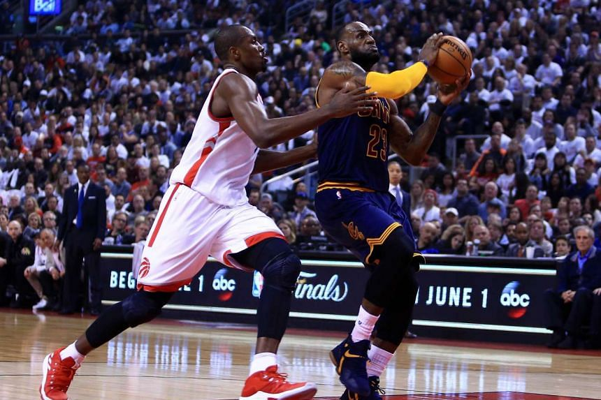 Lebron James (right) of the Cleveland Cavaliers looking to shoot as Serge Ibaka of the Toronto Raptors defends in Game Four of the Eastern Conference Semifinals.