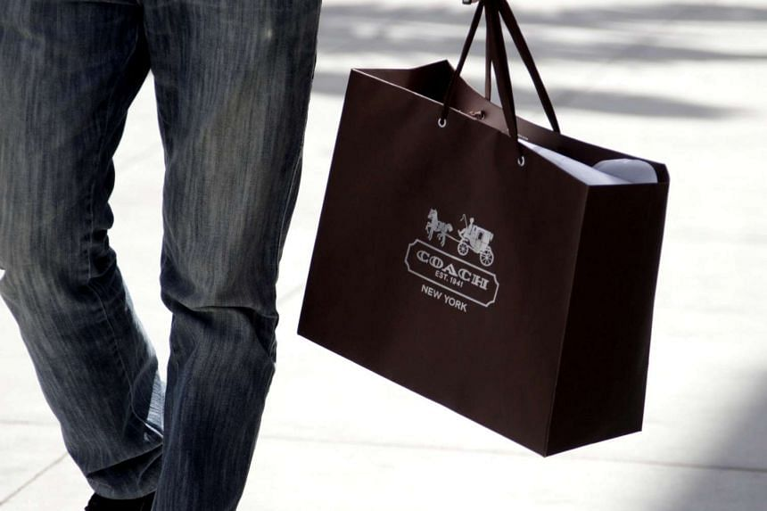 A shopping bag from the luxury brand Coach is seen along Rodeo Drive in Beverly Hills, California, on May 21, 2013.
