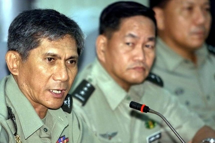 Philippine Armed Forces Chief of Staff Roy Cimatu (left) speaks during a news conference at the military headquarters in Manila, Philippines on July 5, 2002.