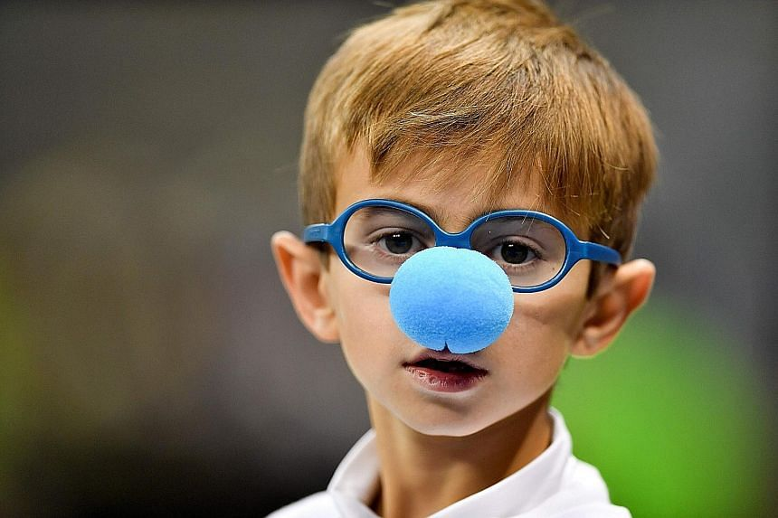 A child wearing a blue nose last Monday in support of World Autism Awareness Day. The researcher says that personal narrative helps to shape the child's development and formation of relationships.