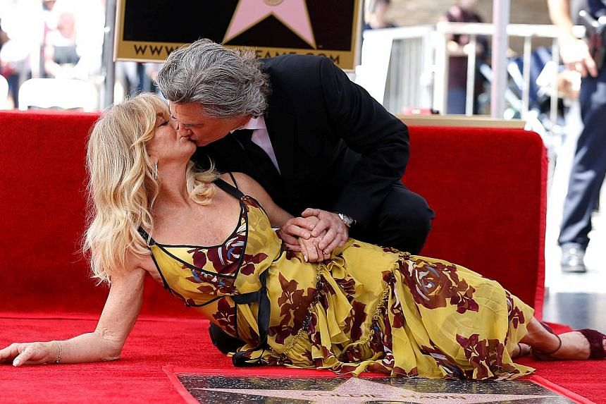 Love is still in the air for actors Kurt Russell, 66, and Goldie Hawn, 71. The couple, who got together in 1983, share a kiss after unveiling their stars on the Hollywood Walk of Fame in Los Angeles last week.