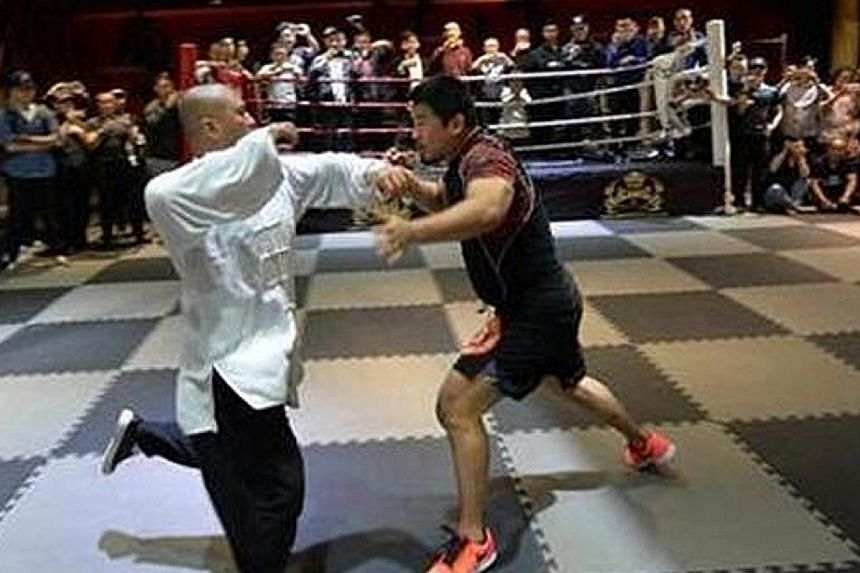 Mixed martial arts fighter Xu Xiaodong (at right) defeated taiji master Lei Lei in just 10 seconds during a fight in Chengdu on April 27.