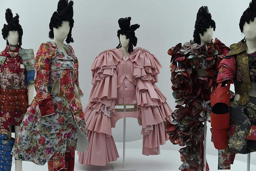 Outfits (above) by Rei Kawakubo at the exhibition held at New York's Metropolitan Museum of Art.
