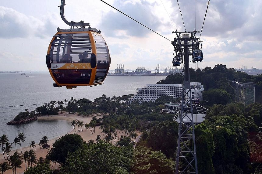 Visitors outside Universal Studios Singapore at Resorts World Sentosa. The Hollywood movie theme park is popular with young and old alike. Launched in 2015, the Sentosa cable car line allows visitors to travel easily around the island while enjoying