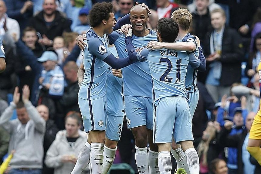 Manchester City skipper Vincent Kompany (centre) celebrates scoring their second goal with Leroy Sane (left), David Silva and Kevin de Bruyne.
