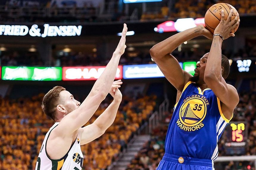 Golden State's Kevin Durant shooting over Gordon Hayward of the Utah Jazz during the 102-91 victory that gave the Warriors a 3-0 lead in their Western Conference semi-final series. Durant scored 38 points and grabbed 13 rebounds to set up the win.