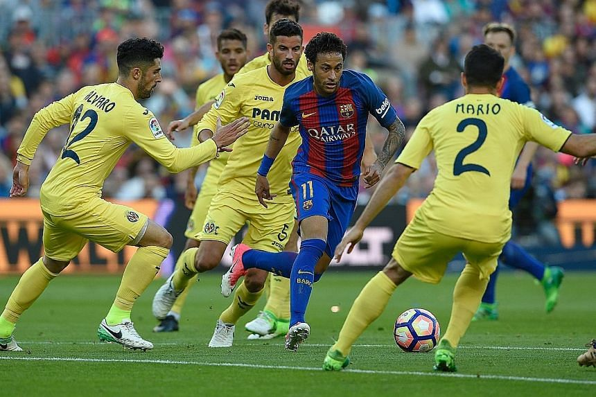 Weaving a path past his opponents, Barcelona's Neymar played a vital role in his side's 4-1 win against Villarreal to keep title rivals Real Madrid on their toes.