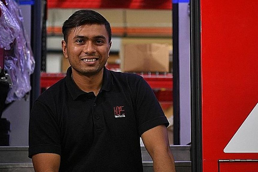 Mr Vic Naidu (above) of Hope Technik was part of the team behind the Fire Medical Vehicle (left). Its unique features will allow firefighters trained in medical services to provide early care to accident victims.