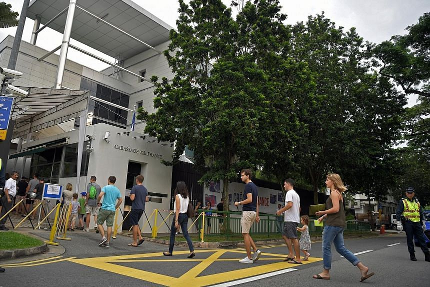 French citizens arriving to vote at the French Embassy in Singapore yesterday. All 12 people whom ST spoke to said they had voted for centrist Emmanuel Macron over far-right leader Marine Le Pen in the run-off polls.