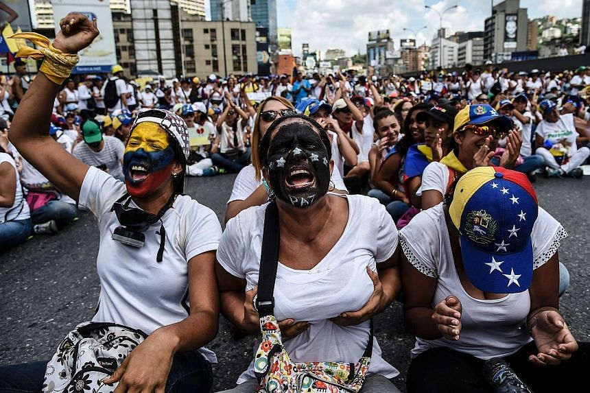 Venezuelan opposition activists taking part in a march in Caracas on Saturday aimed at keeping pressure on President Nicolas Maduro, whose authority is being increasingly challenged by protests and deadly unrest. Some women flashed their breasts in a