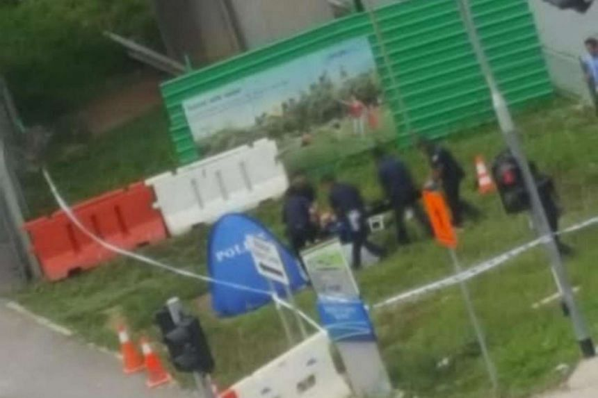 Police officers were seen retrieving the body from the canal.