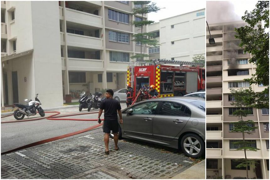Thick, black smoke was seen billowing out of the window of a flat on the seventh storey of Block 338, Ubi Avenue 1.