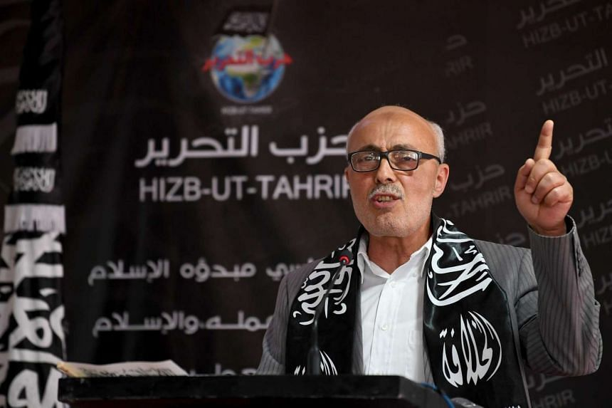 Abderraouf Amri, head of the Political Bureau for the radical Islamist party Hizb ut-Tahrir, delivers a speech at the party headquarters on April 15, 2017.