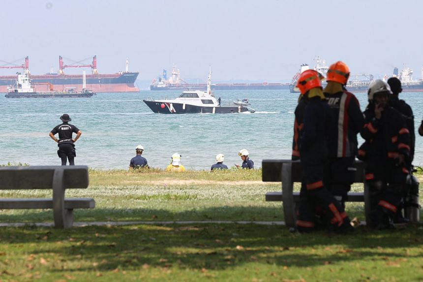 A rescue craft is seen searching a section of the sea near Bedok Jetty for a missing boy on Monday (May 8) afternoon.