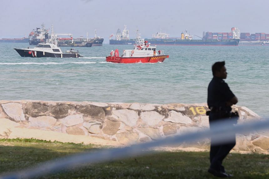 Rescue craft seen searching a section of the sea near Bedok Jetty for a missing boy on Monday (May 8) afternoon.