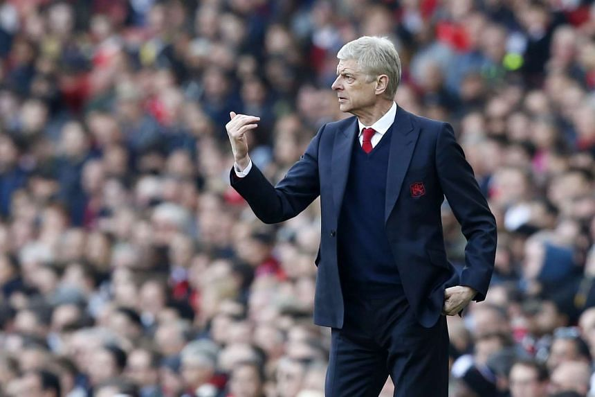 Arsenal manager Arsene Wenger gestures on the touchline during the match against Manchester United on May 7, 2017,