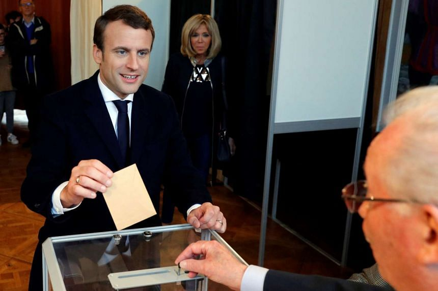 Emmanuel Macron casts his ballot at a polling station in Le Touquet, France on May 7, 2017.