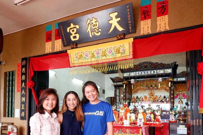 NUS undergraduates (from left) Li Huimin, Sheikha Shamerah and Jasmine Yee, all aged 21, at the Tian Teck Keng temple in Tampines. They were part of a group which helped to document the Chinese temple.