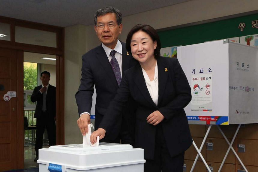 Sim Sang Jung (right), the presidential candidate of the progressive Justice Party, and her husband Lee Seung Bae cast their ballots at a polling booth in Goyang, northwest of Seoul.