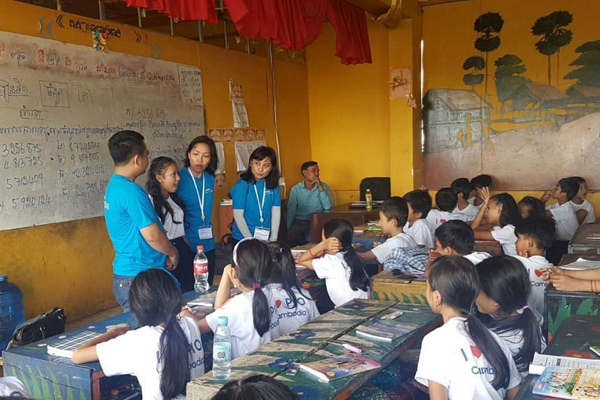 Samsung employees participating in a classroom activity for Samsung Love and Care Programme in Cambodia.