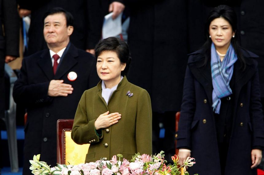 South Korea's former President Park Geun-hye salutes the national flag during her inauguration at the parliament in Seoul on Feb 25, 2013.