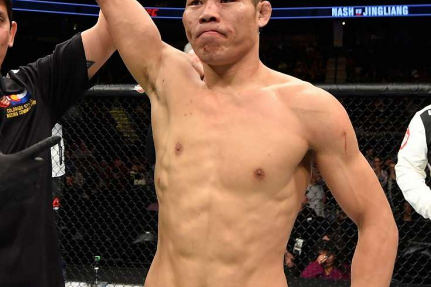 Chinese fighter Li Jingliang is champing at the bit ahead of his welterweight bout against Canada's Jonathan Meunier at UFC Fight Night Singapore, which will be held on June 17 at the Singapore Indoor Stadium. PHOTO: GETTY IMAGES