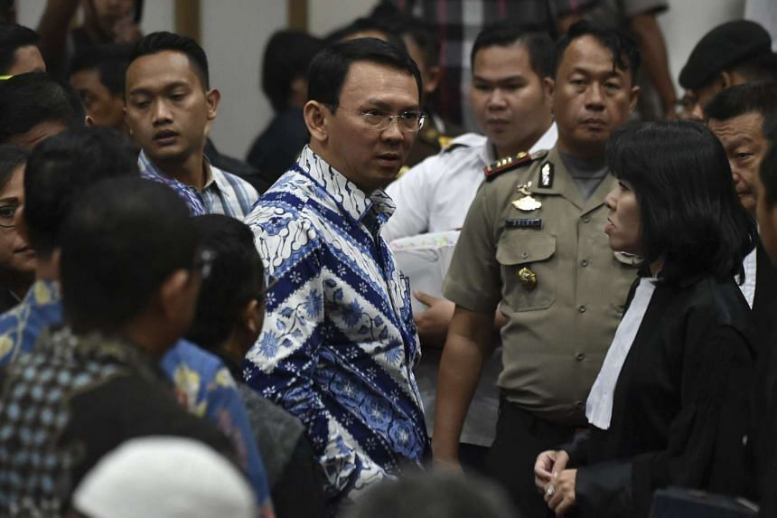 Jakarta's governor Basuki Tjahaja Purnama, popularly known as Ahok, speaks to his lawyers after the end of his trial in Jakarta, Indonesia, May 9, 2017.