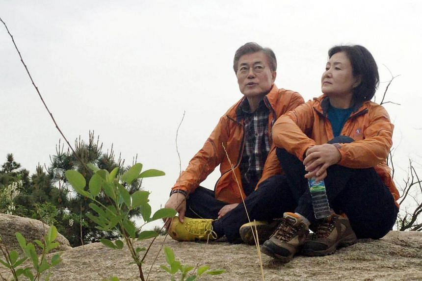 Moon Jae In takes a rest with his wife Kim Jung Sook at a mountain behind his private house in Seoul, South Korea.